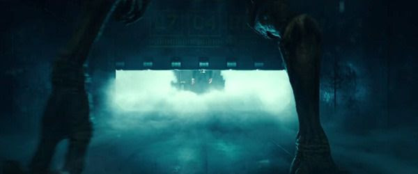 As the cell door rises, Thomas Whitmore (background) prepares to confront an alien prisoner in INDEPENDENCE DAY: RESURGENCE.