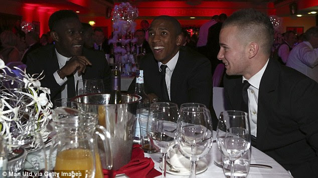 Happy: Hernandez shares a joke with Valencia while Cleverley, Young and Welbeck are all smiles (below)