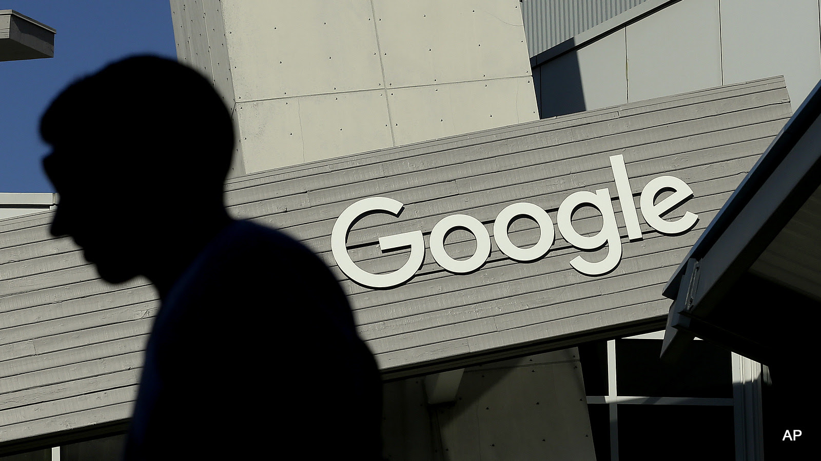 A man walks past a building on the Google campus in Mountain View, Calif. Google recently noted 'Usage of our services have increased every year, and so have the user data request number.'