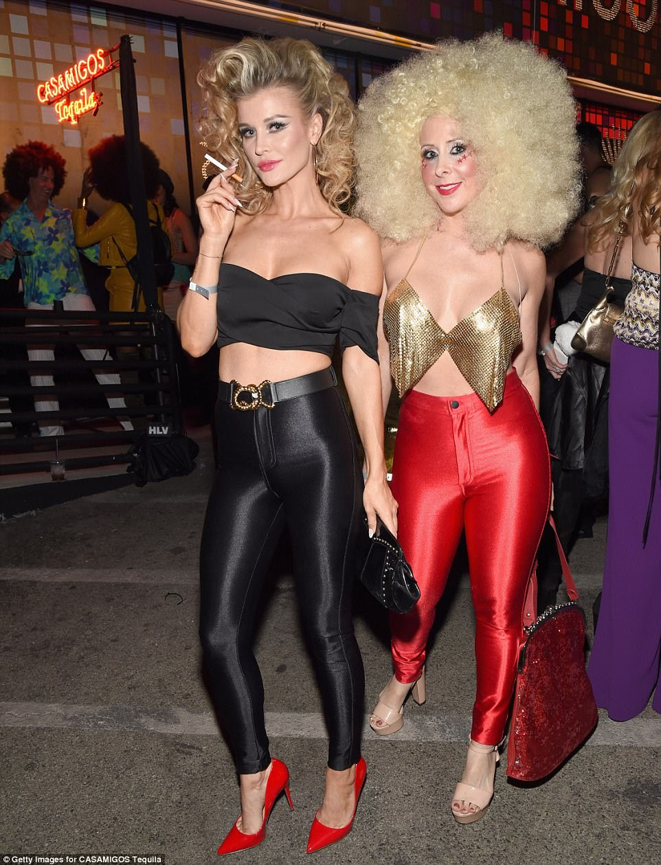 Throwback: Joanna posed with producerTraci Szymanski, who rocked an enormous blonde afro wig