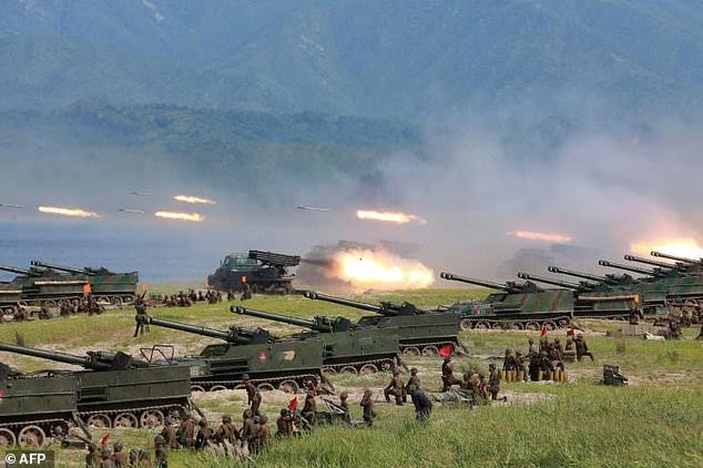North Korea (pictured during a military exercise) may be preparing for its sixth nuclear weapon test, South Korean officials have warned