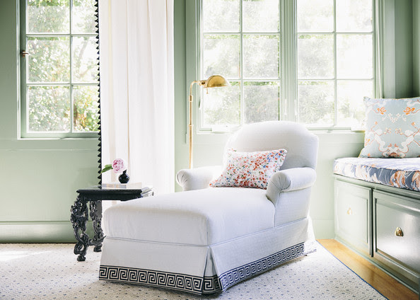Bedroom - A white chaise longue trimmed with a Greek key pattern in a bedroom with floral accents