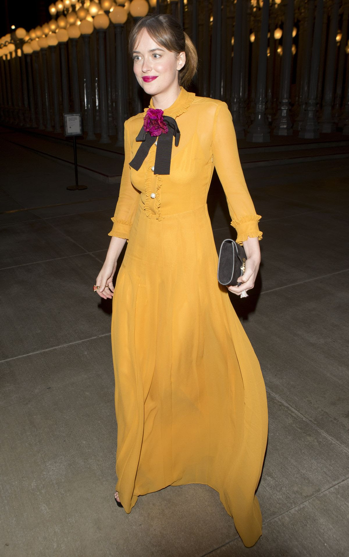 DAKOTA JOHNSON Leaves LACMA Art and Film Gala in Los Angeles 11/07/2015