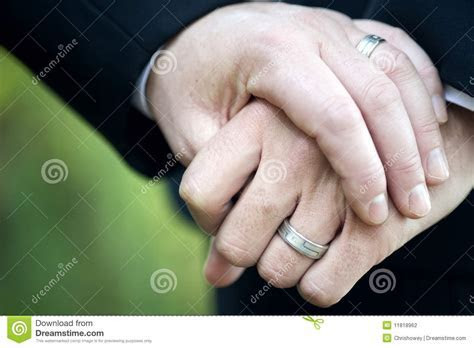 Gay Couple Holding Hands With Wedding Rings Stock