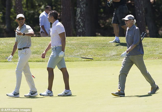 Obama pictured last year golfing on Martha's Vineyard with Larry David and Cryus Walker. On Thursday, he was joined by David and businessmen Robert Wolf and Jonathan Lavine for a round of golf