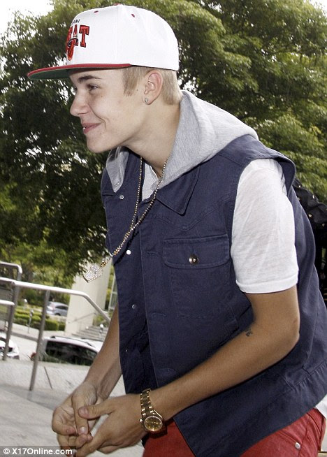 Low profile: Justin tried to keep his head down as he ambled to a meeting in LA yesterday