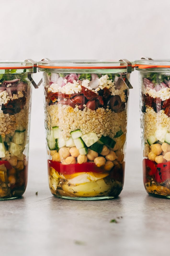 Greek Quinoa Salad Jars - these jars are prefect for meal prepping and popping them in the refrigerator for the week ahead. Swap the ingredients for ones you like, this is so customizable! #saladjars #greeksaladjars #quinoasaladjars | Littlespicejar.com