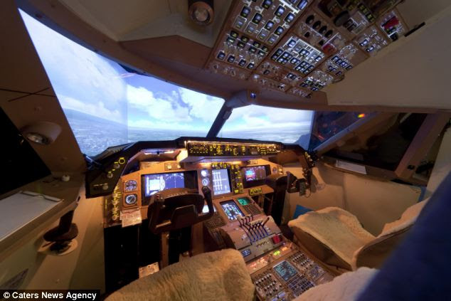 Detailed: He forked out a staggering £20,000 constructing the simulator, which features a six-foot screen