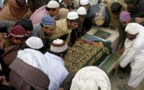 In this Dec. 29, 2010, file photo, Pakistani villagers carry the shrouded casket of a person reportedly killed by a US drone attack in Pakistani tribal area of Mir Ali along the Afghanistan border, during his funeral in Bannu, Pakistan. (AP Photo)