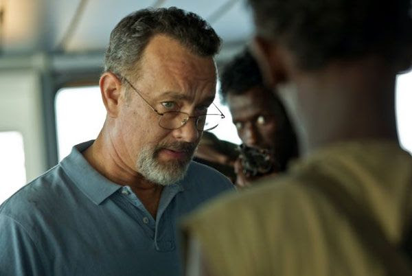 Aboard the bridge of the cargo ship MV Maersk Alabama, Captain Richard Phillips (Tom Hanks) confronts the Somali pirate leader Muse (Barkhad Abdi) in CAPTAIN PHILLIPS.