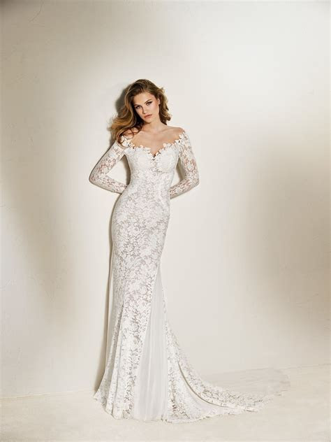 Chanda: Long sleeve mermaid wedding dress in lace and