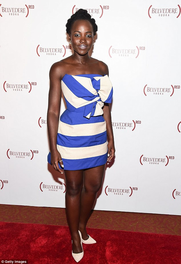 All eyes on her! Lupita Nyong'o, 33, stunned in a blue and white mini-dress as she attended the Belvedere Presents One Night for Life with John Legend at The Apollo Theater in New York on Saturday