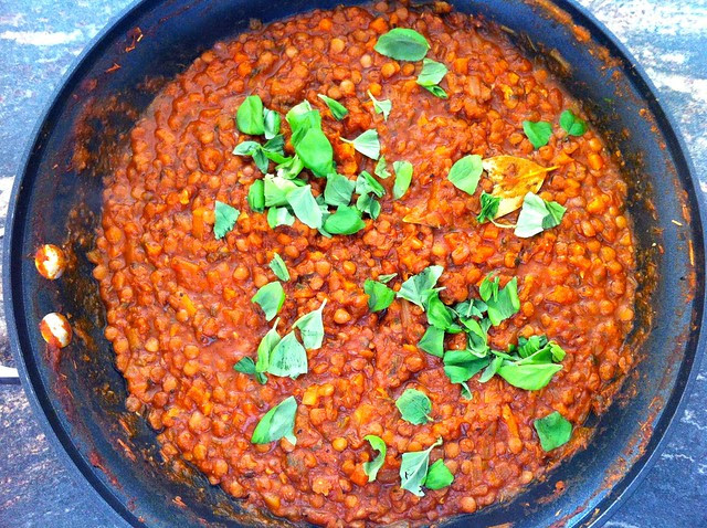 Sprinkling Lentil Marinara Sauce with Torn Fresh Basil