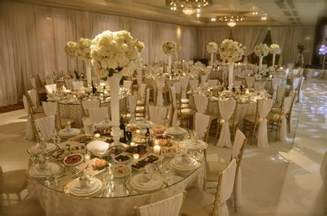 All white wedding with gold accents. Draped chiavari