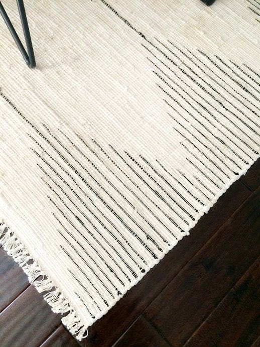 Le Fashion Blog Stylish Whimsical Work Space Urban Outfitters Woven Striped Rug Dark Wood Floors Office Decor