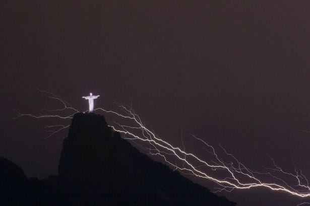Striking: Lightning hits Christ the Redeemer statue in Rio de Janeiro.