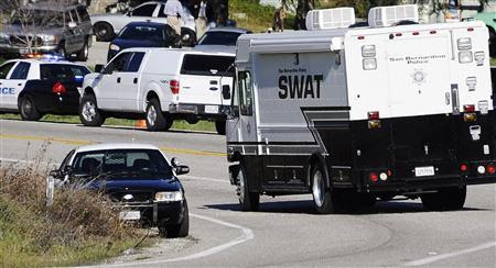 Authorities move into position during a manhunt for former LAPD officer Christopher Dorner, who is wanted in connection to the murders of three people, near the town of Angelus Oaks, California February 12, 2013. REUTERS-Gene Blevins