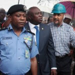 Governor Ambode being conducted round the Iyana Ipaja tanker explosion accident scene by the Permanent Secretary, Ministry of Special Duties, Mr. Aderemi Desalu
