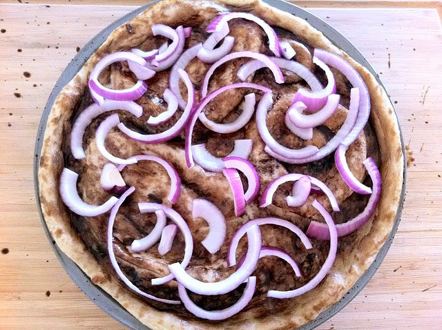 Red Onion Added Over Pizza