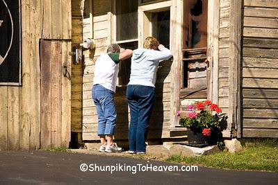Sheila and Linda Peering into Lumber Office, Monroe County, Wisconsin