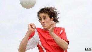 footballer doing a header