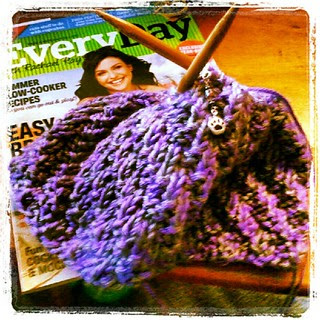Sunday #knitting and #reading fun! #yarn #cowl #rachaelrayeveryday #getyourkniton
