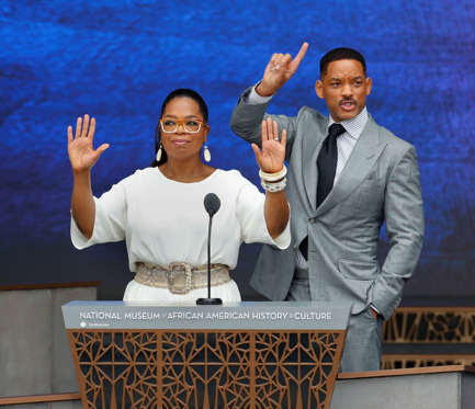 Oprah Winfrey and Will Smith speak at the dedication ceremony for the Smithsonian Museum of African American History and Culture on the National Mall in Washington, Saturday, Sept. 24, 2016. (AP Photo/Pablo Martinez Monsivais)