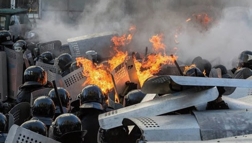 Anti-government rioters clashing with police in Ukraine. The western-backed opposition is seeking to overthrow the existing government. by Pan-African News Wire File Photos