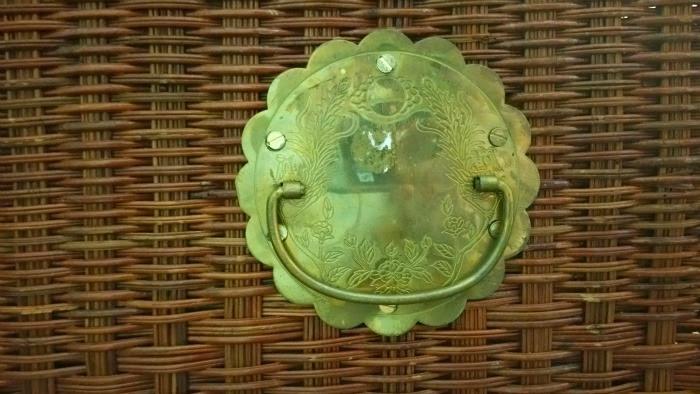 dark wicker trunk boho vintage style with ornate brass hardware