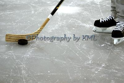 hockey skating on the ice