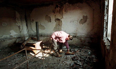 Albanian man in ruined house