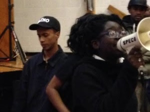 Newark Student Union leaders Jose Leonardo (left) and Tanaisa Brown, lead chants in White's support