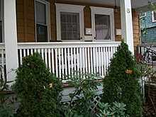 Picture of a porch, including a railing, and columns