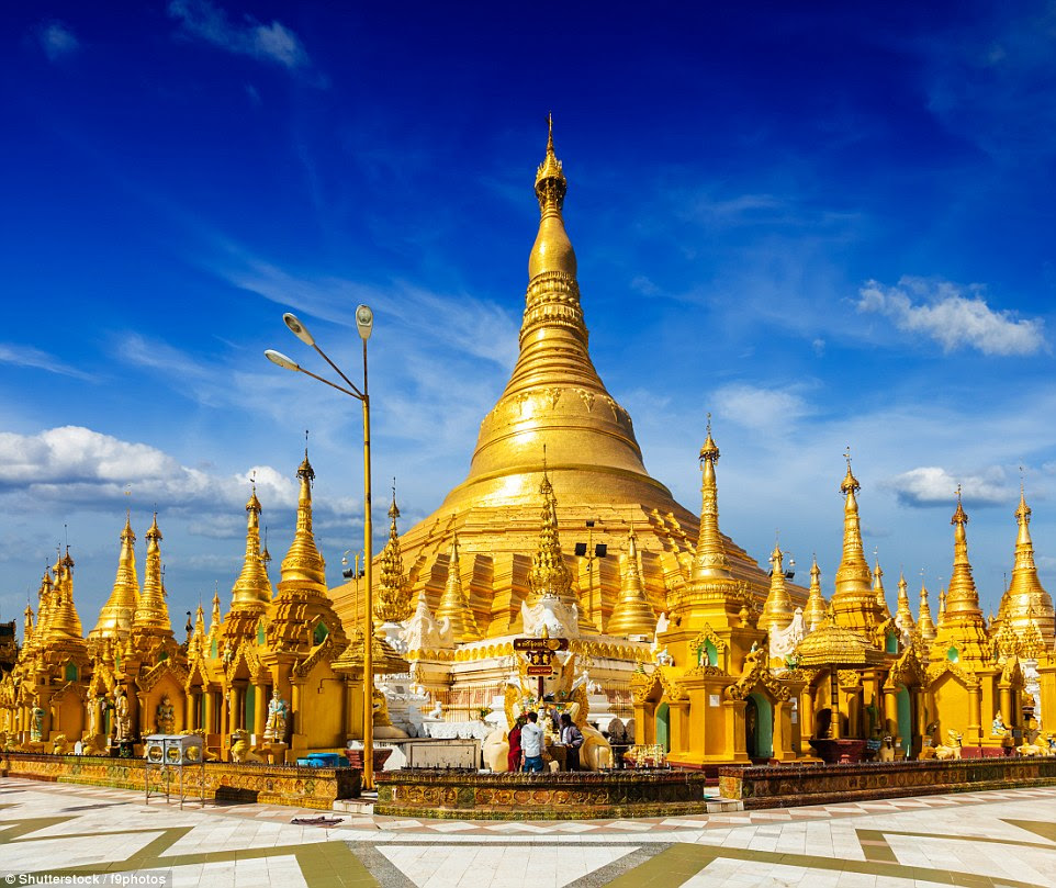 Shwedagon Paya Pagoda in Yangon, Myanmar: The building is covered with hundreds of gold plates and the top of the stupa is encrusted with around 5,000 diamonds - the largest of which is apparently a 72 carat diamond