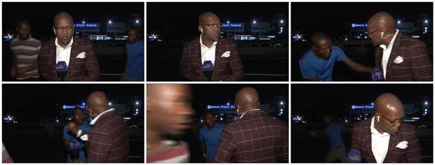 Dois homens armados foram filmados na noite desta terça-feira (10) ao assaltarem um repórter sul-africano que se preparava para entrar ao vivo em um canal de TV local com uma reportagem (Foto: SABC via Reuters TV )