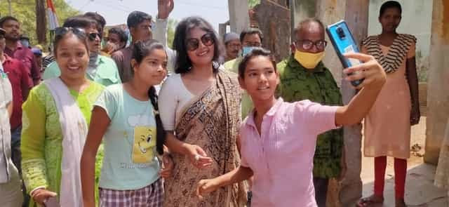People clicking selfies with TMC candidate Saayoni Ghosh during a campaign at Asansol South constituency.