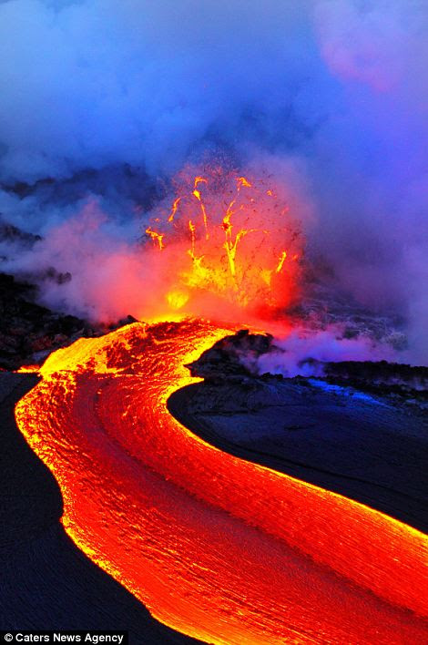 Steam: Lava flows from the volcanic island into the water