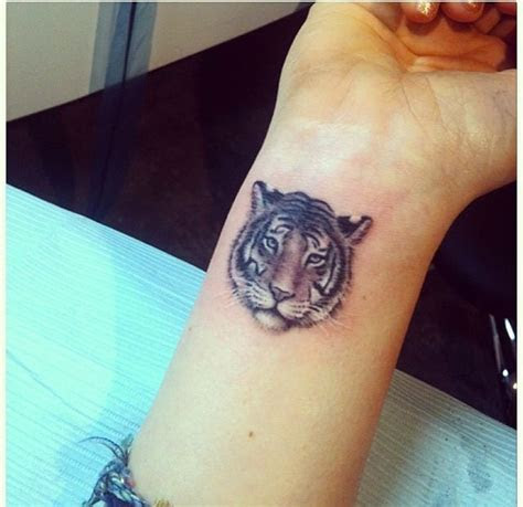 tiger tattoo  wrist tiger face tattoo tiger tattoo