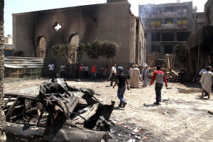 Egyptian gather in the ruins of the Evangelical Church…