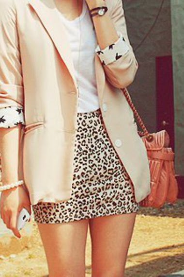 Leopard skirt and pale blazer.