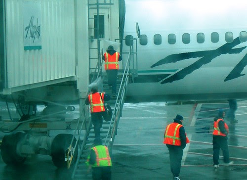 Alaska Airlines' Menzies Ground Crew with heads in plastic bags.