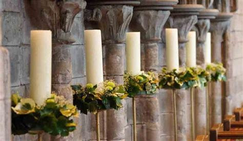 Large candle holders with white candles and floral