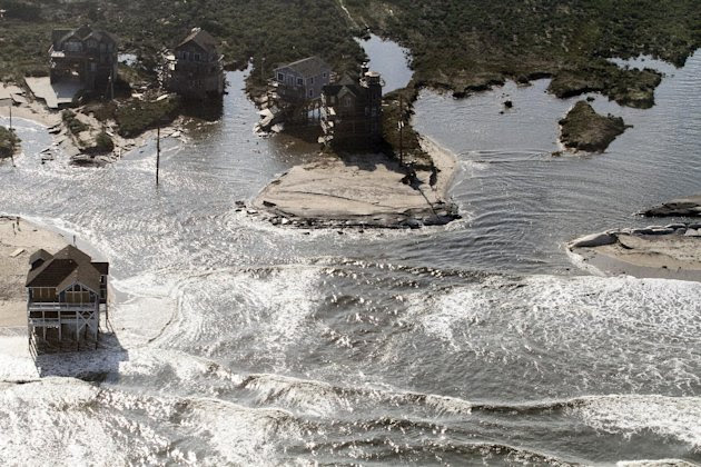 A flooded road is seen in Hatteras Island, N.C., Sunday, Aug. 28, 2011after Hurricane Irene swept through the area Saturday cutting the roadway in five locations. Irene caused more than 4.5 million ho