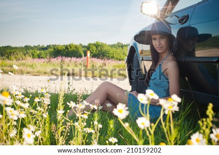 http://www.shutterstock.com/pic-210159202/stock-photo-young-pretty-woman-sitting-near-green-car.html?src=20jnPXTwhwly-kLT_TQsjA-1-30