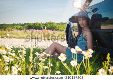 http://www.shutterstock.com/pic-210159202/stock-photo-young-pretty-woman-sitting-near-green-car.html?src=20jnPXTwhwly-kLT_TQsjA-1-30