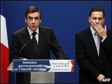 Francois Fillon (left) gives a press conference, next to Eric Besson in Paris, 8 February 2010