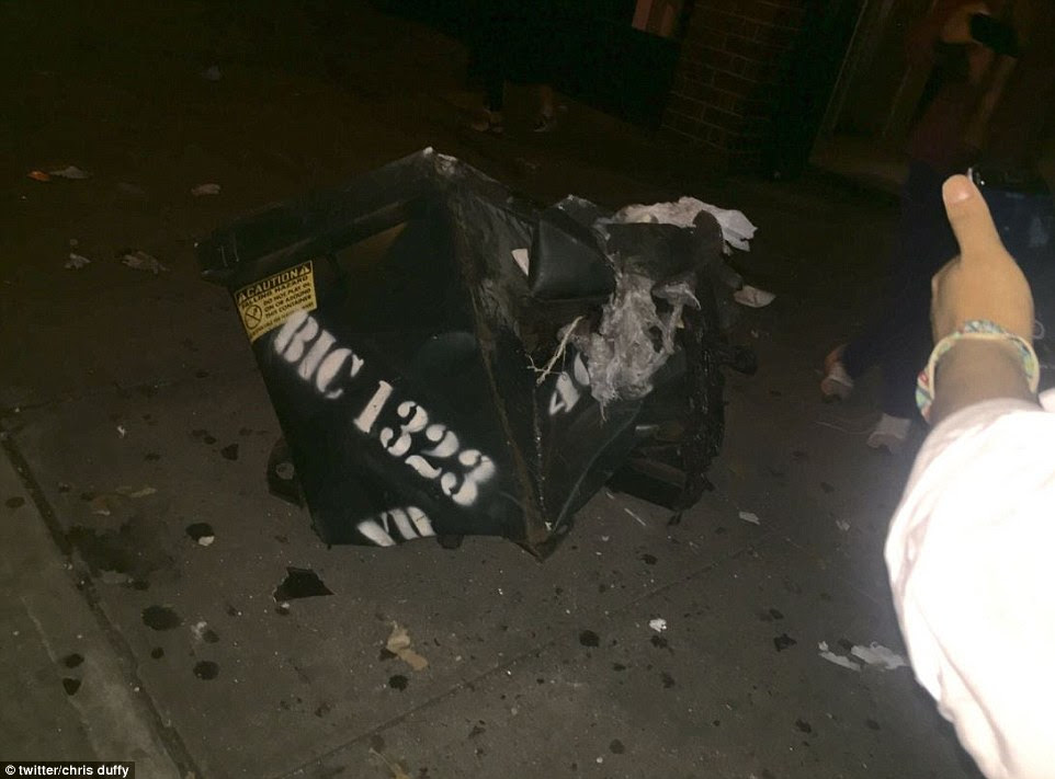 The blast in Chelsea is thought to have come from a dumpster (pictured) and could have come from an explosive device. Witness Chris Duffy tweeted this photo of a destroyed dumpster and said it was the source of the blast