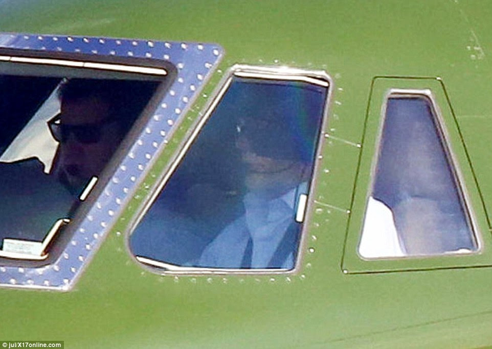 Ford (right) who played space pilot Han Solo in the popular sci-fi franchise Star Wars, looked ready for take-off in the cockpit of the plane
