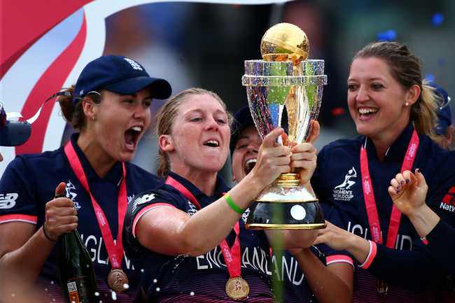 Heather Knight, England captain, lifts the coveted trophy.
