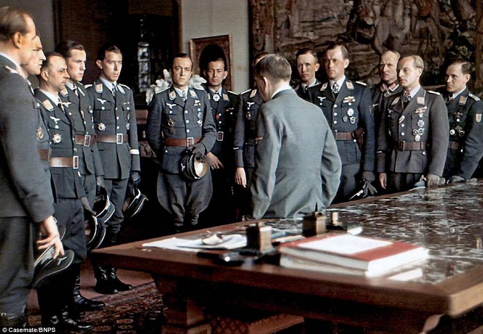 Hitler greeting Luftwaffe commanders to his Berghof retreat in April 1944. By this point in the war - facing a crippling fuel shortage and a lack of production facilities - the air force had largely been reduced to operating anti-aircraft flak batteries